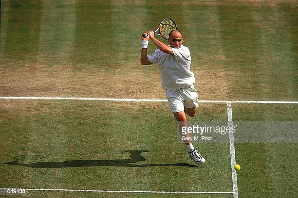 Andre Agassi of the USA in action in the semi final game at the Wimbledon Lawn Tennis Championship at the All England Lawn Tennis and Croquet Club...