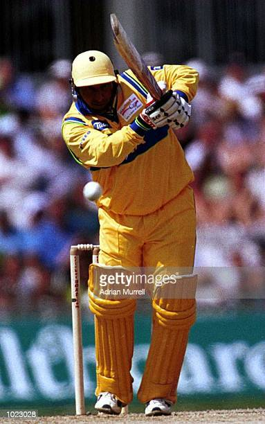 Aravinda de Silva of Asia on his way to 35 before being caught and balled by Chris Cairns of the Rest of the World during the match between Asia and...