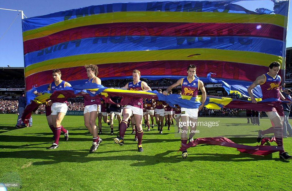 Brisbane run through their banner at the start of the match between the Adelaide Crows and the Brisbane Lions in round 20 of the AFL played at Football Park in Adelaide, Australia. Brisbane 17.13 (115) defeated Adelaide 11.12 (78) DigitalImage. Mandatory Credit: Tony Lewis/ALLSPORT