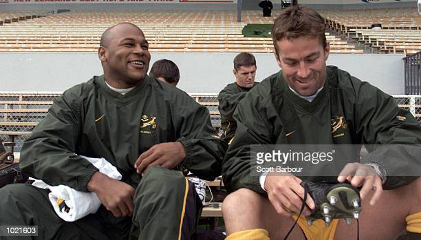 Chester Williams and Corne Krige share a joke during the South African training session in preparation for the TriNations match against the New...