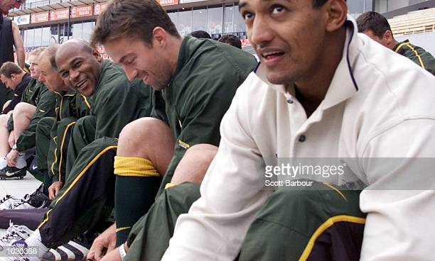 Chester Williams Corne Krige and Breyton Paulse of South Africa share a joke during the South African training session in preparation for the...