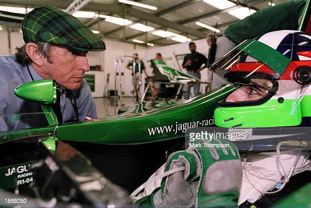 Dario Franchitti in the pits with Jackie Stewart during testing the Jaguar F1 Car at Silverstone