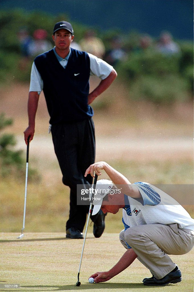 David Toms of the USA marks his ball as Tiger Woods looks on during the third round of the British Open Golf Championships at the Old Course, St Andrews, Scotland. Mandatory Credit: Harry How/ALLSPORT