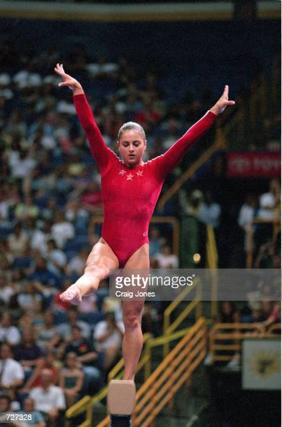 Dominque Moceanu shows grace during the Balance Beam Event of the John Hancock US Gymnastics Championships at the Kiel Center in St Louis...