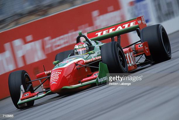 Driver Adrian Fernandez of Mexico who drives the Ford Reynard 2KI for Patrick Racing speeds down the track during the Target Grand Prix of Chicago...
