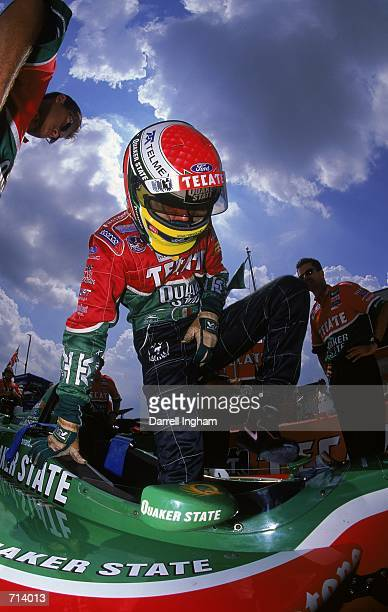 Driver Adrian Fernandez of Mexico who drives the Ford Reynard 2KI for Patrick Racing gets out of his car during the Target Grand Prix part of the...