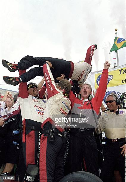 Driver Cristiano da Matta of Brazil who drives the Toyota Reynard 2KI for PPI Motorsports gets lifted up by his team after winning first place in the...