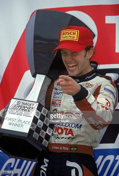 Driver Cristiano da Matta of Brazil who drives the Toyota Reynard 2KI for PPI Motorsports celebrates while holding his trophy on the winners platform...