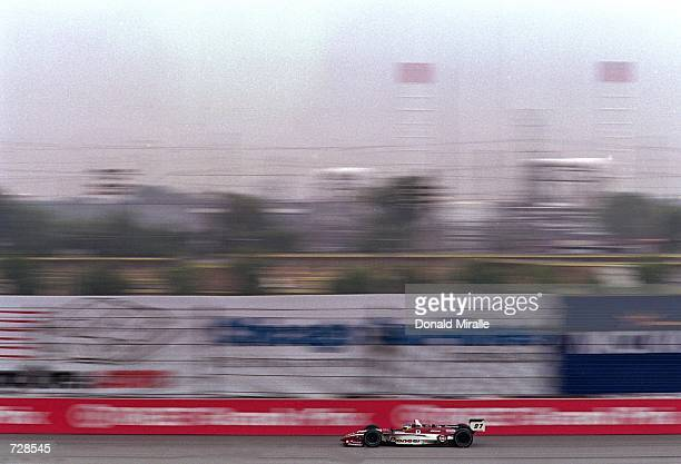Driver Cristiano de Matta of Brazil who drives a Toyota Reynard 2KI for PPI Motorsports speeds down the track during the Target Grand Prix of Chicago...