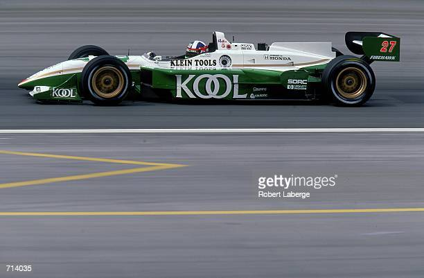 Driver Dario Franchitti of Great Britain who drives the Honda Reynard 2KI for Team KOOL Green is racing during the Target Grand Prix part of the 2000...