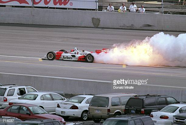 Driver Helio Castroneves of Brazil who drives the Honda Reynard 2KI for Marlboro Team Penske has an engine fire during the Target Grand Prix part of...