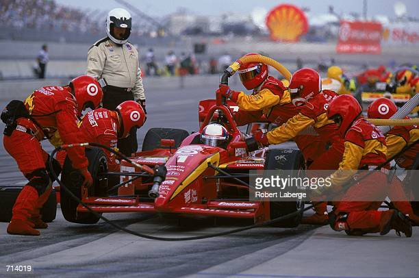 Driver Juan Montoya of Columbia who drives the Toyota Lola 2KI for Target/Chip Ganassi Racing makes a stop in the pit lane during the Target Grand...