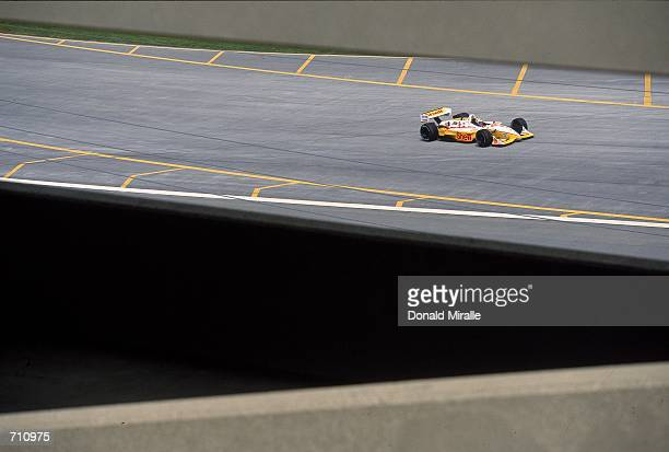 Driver Kenny Brack of Sweden who drives the Ford Reynard 2KI for Team Rahal speeds down the track during the Target Grand Prix of Chicago Presented...