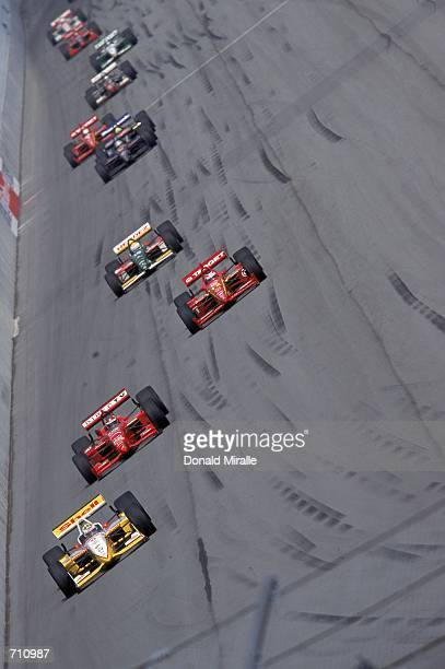 Driver Kenny Brack of Sweden who drives the Ford Reynard 2KI for Team Rahal leads the pack down the track during the Target Grand Prix of Chicago...