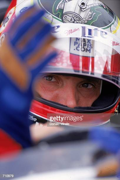 Driver Max Papis of Italy who drives the Ford Reynard 2KI for Team Rahal looks on from his car during the Target Grand Prix of Chicago Presented by...