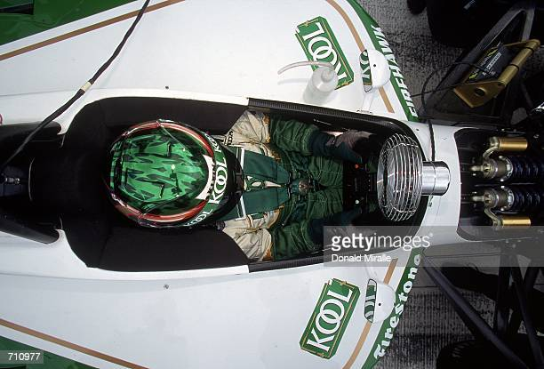 Driver Paul Tracy of Canada who drives the Honda Reynard 2KI for Team KOOL Green sits in his car during the Target Grand Prix of Chicago Presented by...