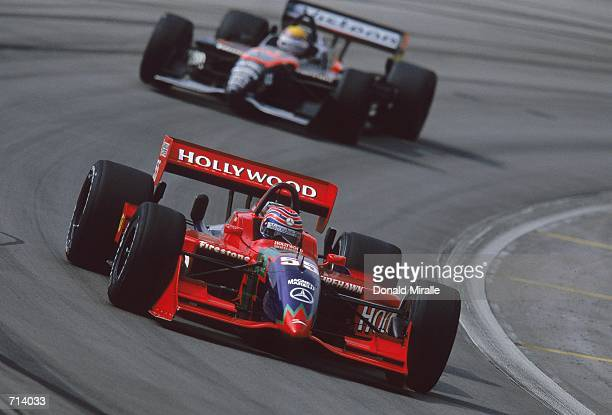 Driver Tony Kanaan of Brazil who drives the Mercedes Reynard 2KI for Mo Nunn Racing is racing during the Target Grand Prix part of the 2000 CART...
