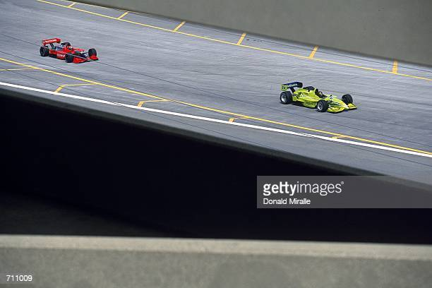 Drivers Oriol Servia of Spain who drives the Toyota Reynard 2KI for PPI Motorsports and Tony Kanaan of Brazil who drives the Mercedes Reynard 2KI for...