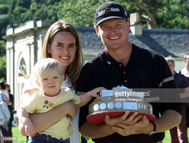Ernie Els of South Africa poses with the trophy with his wife Liesl and daughter Samantha after winning the Standard Life Loch Lomond Tournament at...
