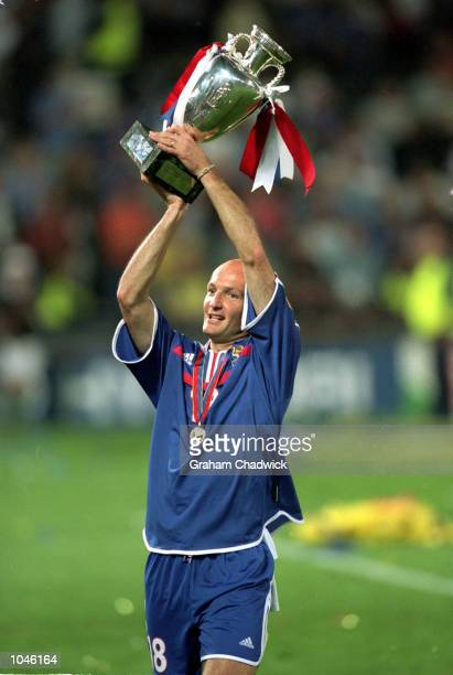 Frank LeBoeuf of France holds the trophy after the European Championships 2000 Final against Italy at the De Kuip stadium Rotterdam Holland France...