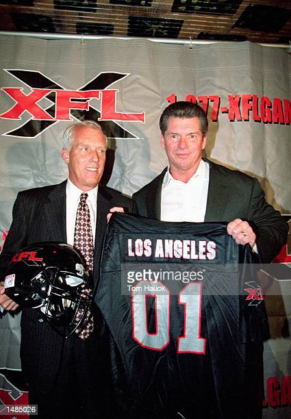 General Manager JKMcKay and Vince McMahon poses with a XFL jersey during the XFL Press Conference at the House of Blues in Los Angeles...