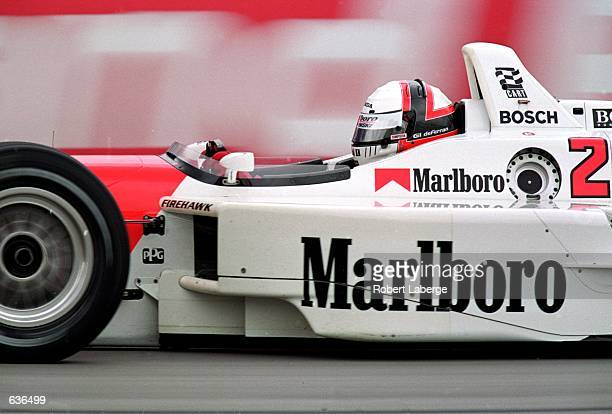 Gil de Ferran of Brazil who drives a Honda Reynard 2KI for Marlboro Team Penske goes by during the Target Grand Prix of Chicago part of the CART...