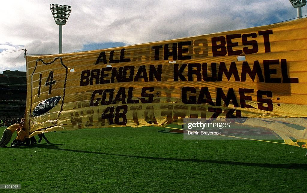 Hawthorn players run through banner before the match between the Hawthorn Hawks and Port Adelaide Power , during round 20 of the AFL season played at the M.C.G in Melbourne, Australia. Mandatory Credit: Darrin Braybrook/ALLSPORT
