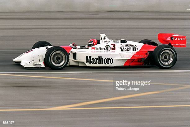 Helio Castroneves of Brazil who drives a Honda Reynard 2KI for Marlboro Team Penske goes by during the Target Grand Prix of Chicago part of the CART...