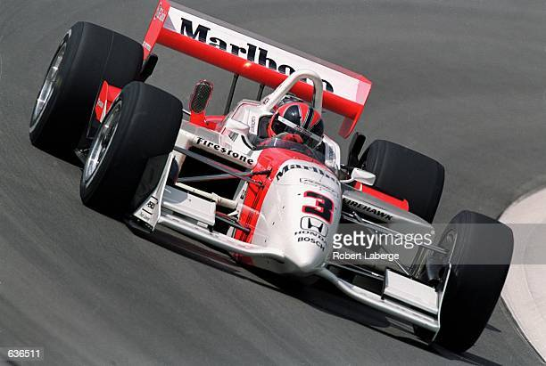 Helio Castroneves of Brazil who drives a Honda Reynard 2KI for Marlboro Team Penske speeds around the track during the Target Grand Prix of Chicago...