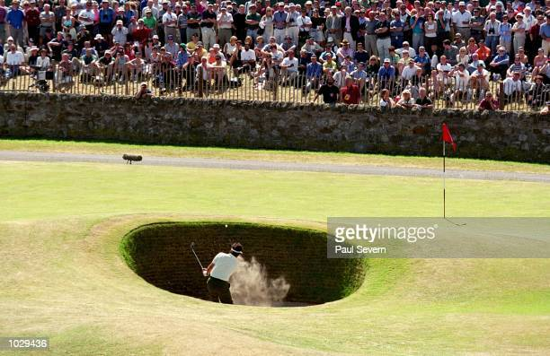 Jean Van de Velde of France plays out of the Road Hole Bunker on the 17th during the second round of the British Open on the Old Course at St Andrews...