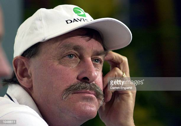 John Newcombe of Australia ponders the future at the press conference held after Australia won the semifinal of the Davis Cup against Brazil at ANZ...