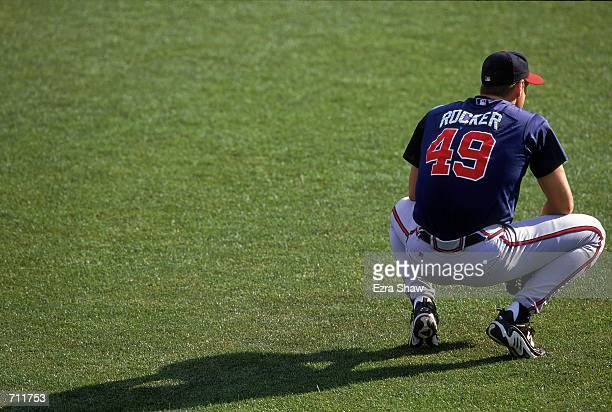 John Rocker of the Atlanta Braves kneels on the field during the game against the New York Mets at Shea Stadium in Flushing New York The Mets...