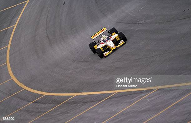 Kenny Brack of Sweden who drives a Ford Reynard 2KI for Team Rahal comes around a corner during the Target Grand Prix of Chicago part of the CART...