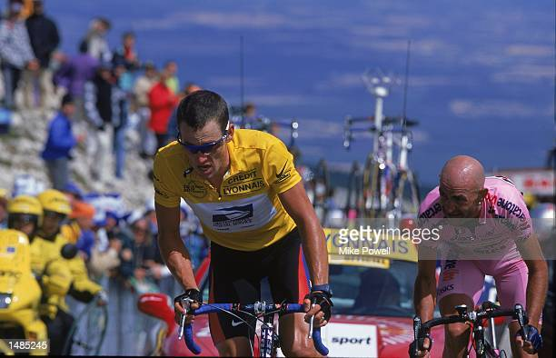 Lance Armstrong of the U.S. Postal Service Team wears the Yellow Jersey as he pumps up a hill during Stage 12, Carpentras to Mont Ventoux, France of...