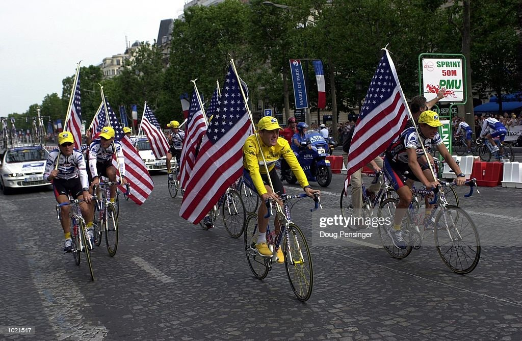 Lance Armstrong of the USA and the US Postal team rides the Champs Elysees after the Final Stage 21 of the 2000 Tour De France, France. Mandatory Credit: Doug Pensinger/ALLSPORT