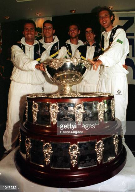 Left to right Captain Ricardo Acioly Andre Sa Gustavo Kuerten Fernando Meligeni and Jaime Ongins of Brazil pose with the Davis Cup during a press...