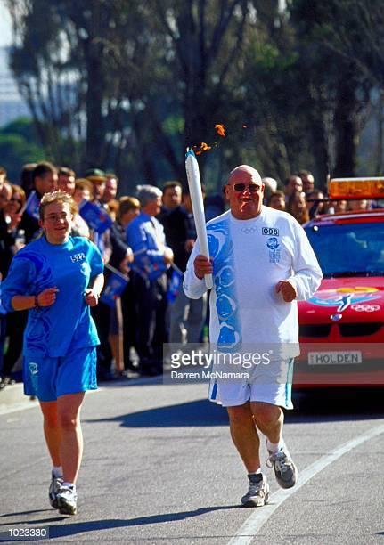 Lindsay Fox carries the Olympic Torch through the streets of Melbourne Australia Mandatory Credit Darren McNamara/ALLSPORT