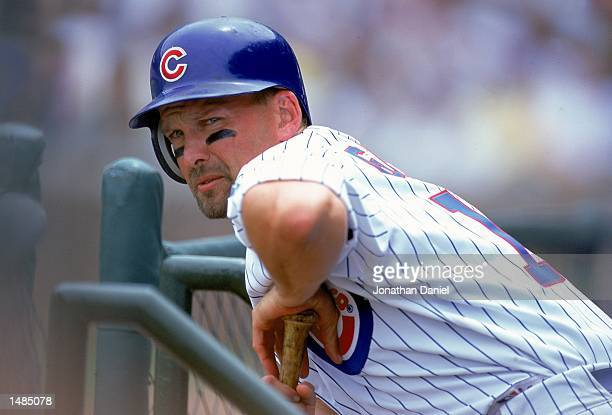 Mark Grace of the Chicago Cubs stretches over his bat during the game against the Chicago White Sox at Wrigley Field in Chicago, Illinois. The Cubs...