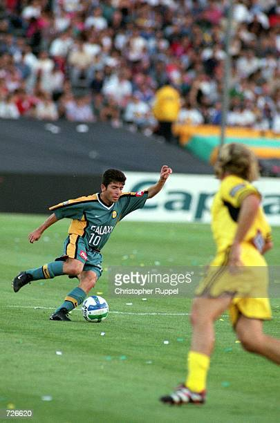 de0631706d2 Mauricio Cienfuegos of the Los Angeles Galaxy runs with the ball during the  game against the