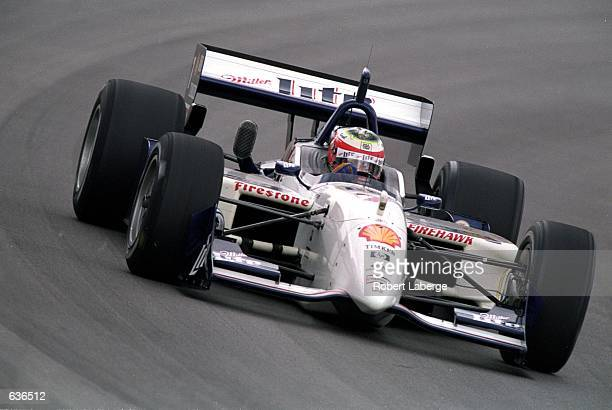 Max Papis of Italy who drives a Ford Reynard 2KI for Team Rahal speeds around the track during the Target Grand Prix of Chicago part of the FedEx...