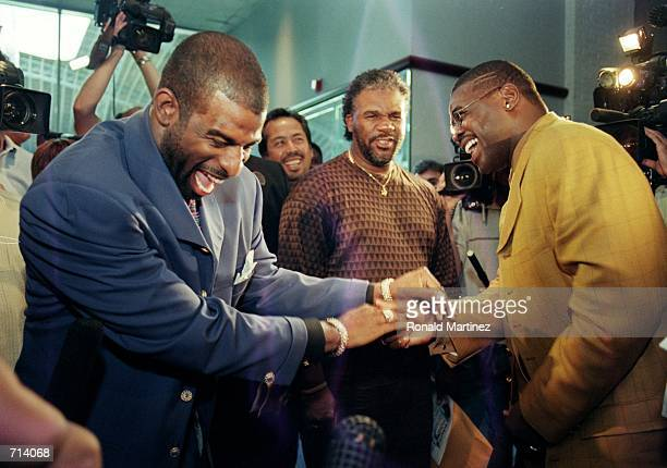 Michael Irvin of the Dallas Cowboys has a laugh with Deon Sanders during his Retirement Press Conference at Texas Stadium in Irving TexasMandatory...