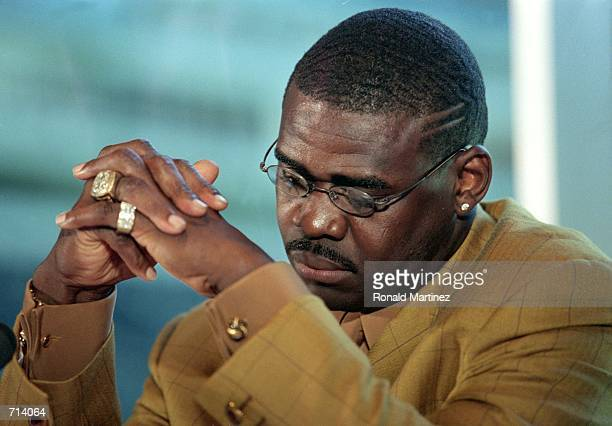Michael Irvin of the Dallas Cowboys looks down during his Retirement Press Conference at Texas Stadium in Irving TexasMandatory Credit Ronald...