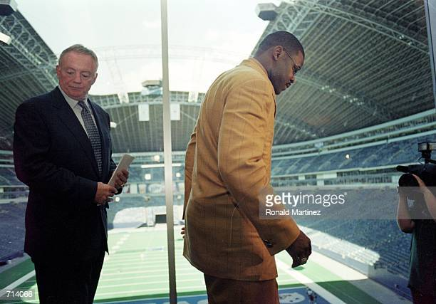 Michael Irvin of the Dallas Cowboys walks out of the press room followed by Owner Jerry Jones during the Retirement Press Conference at Texas Stadium...