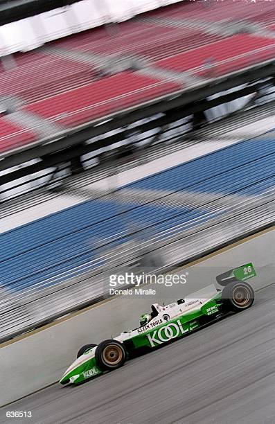 Paul Tracy of Canada who drives a Honda Reynard 2KI for Team KOOL Green speeds around the track during the Target Grand Prix of Chicago part of the...