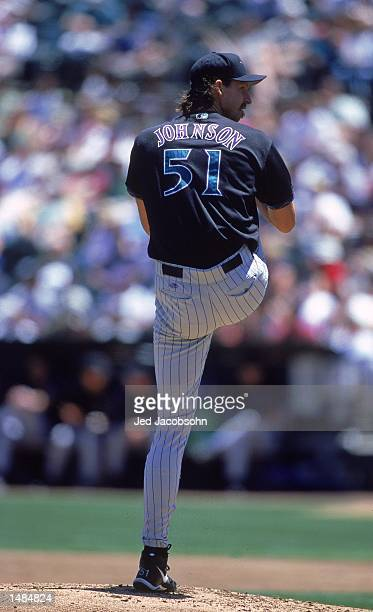 Pitcher Randy Johnson of the Arizona Diamondbacks winds up to pitch during the game against the Oakland Athletics at the Network Associates Coliseum...