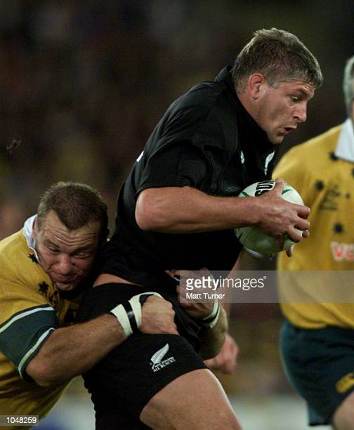 Richard Harry of Australia tackles Captain Todd Blackadder of New Zealand during the match between Australia v New Zealand for the Bledisloe Cup at...