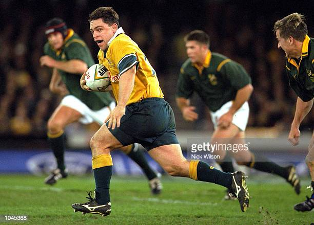 Rod Kafer for Australia runs with the ball in the match between the Australian Wallabies and the South African Springboks for the Nelson Mandela...