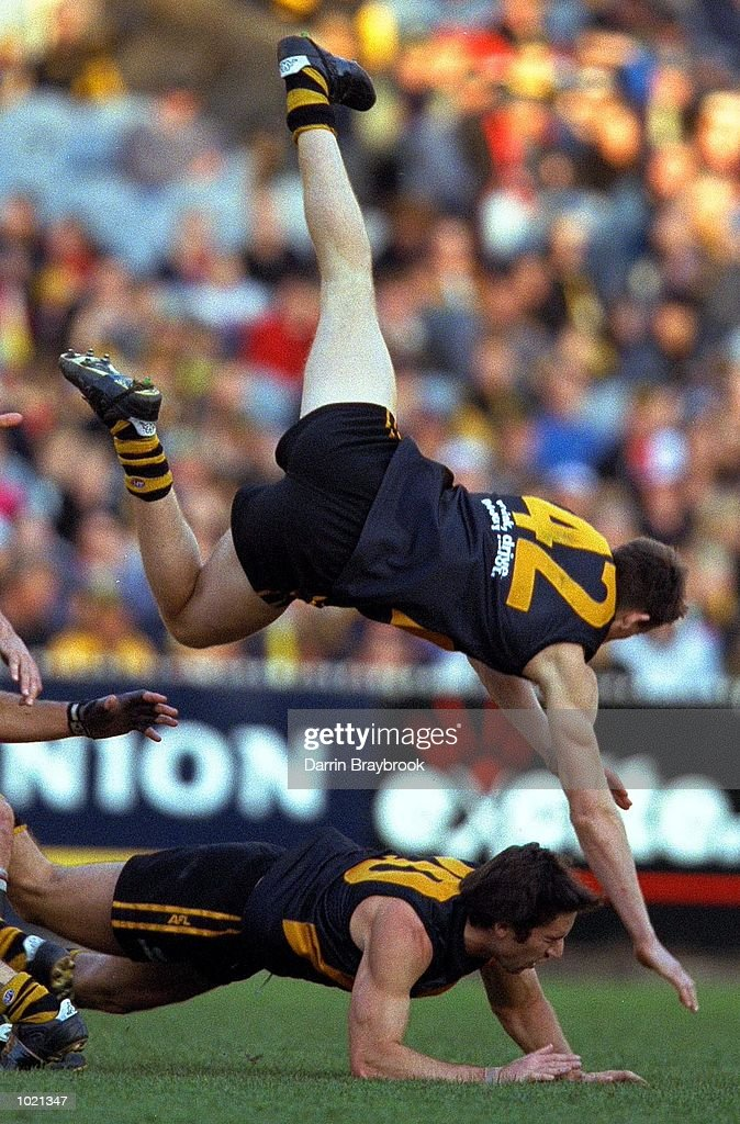 Royce Vardy #42 for Richmond comes crashing down on team mate Ben Harrison #20 in the match between the Richmond Tigers and the St Kilda Saints, during round 20 of the AFL season played at the Melbourne Cricket Ground in Melbourne, Australia. Richmond 18.11 (119) defeated St Kilda 12.7 (79). Mandatory Credit: Darrin Braybrook/ALLSPORT