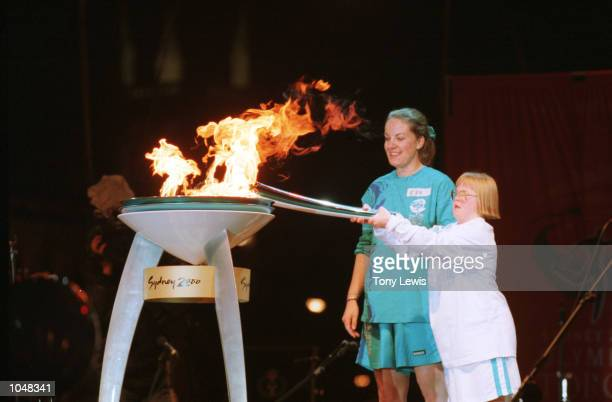 Therese Garton Down's syndrome sufferer and Special Olympian lights the Olympic cauldron in Victoria Square Adelaide Australia With her is her mother...