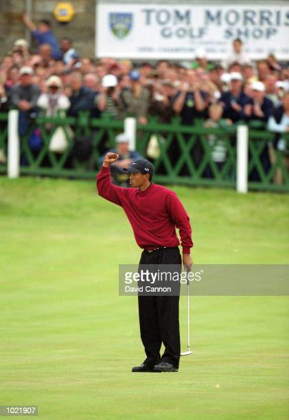 Tiger Woods of the USA celebrates victory at the last hole of the British Open Championship at St Andrews Links Old Course in Fife Scotland Mandatory...
